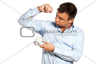 one man sweat stain perspire drying shirt