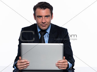 business man holding  laptop computer looking at camera