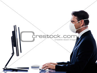 Caucasian Man portrait with computer wearing protection mask