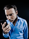 Man Portrait Angry looking at telephone videophone smartphone
