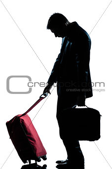 caucasian business traveler man tired with suitcase   silhouette