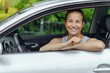 Smiling Pretty Woman Leaning on Car Window