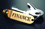 Finance written on Golden Keyring.