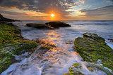 Ocean flows around the rocks at Bungan Beach