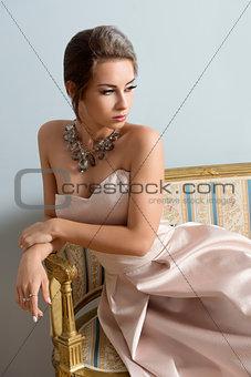 charming aristocratic girl on sofa