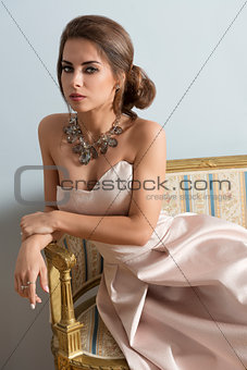 rich girl on ancient sofa