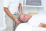 Man receiving neck massage