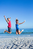 Happy couple jumping together