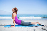 Brunette doing yoga on exercise mat