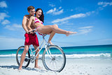 Happy couple going on a bike ride