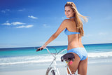 Pretty blonde woman going on a bike ride