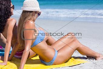 Beautiful women sitting on the towel