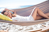 Brunette relaxing in the hammock