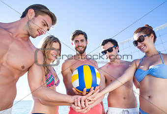 Group of friends holding volleyball