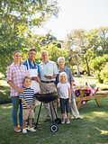 Happy family doing barbecue in the park