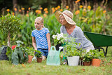 Happy grandmother with her granddaughter gardening
