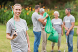 Happy volunteer collecting rubbish
