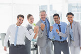 Business people cheering in office