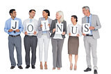 Business people holding letters sign