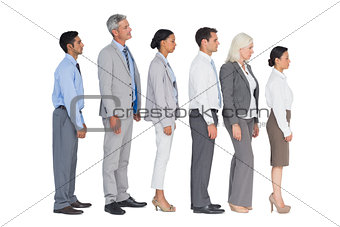 Business people standing behind the other