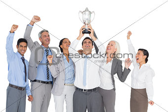 Business people holding cup and cheering