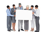 business people holding blank board