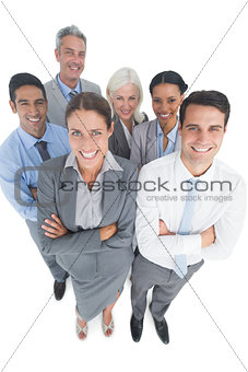 Smiling business people looking at camera with arms crossed