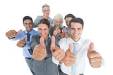 Happy business people looking at camera with thumbs up