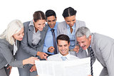 happy business people looking at newspaper