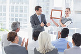 Business people receiving award