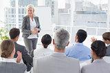 Businesswoman doing speech during meeting