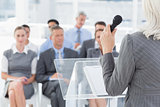 Businesswoman doing speech during meeting
