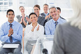 Business people applauding during meeting
