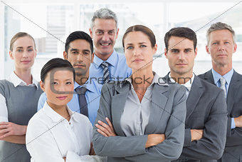 Business people looking at camera with arms crossed