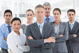 Unhappy business people looking at camera with arms crossed