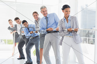 Business people pulling rope
