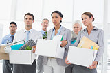 Unhappy fired business people holding box