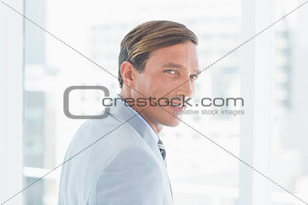 portrait of happy businessman looking at camera