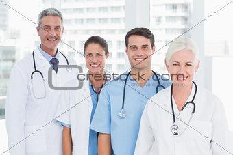 Portrait of confident doctors in row