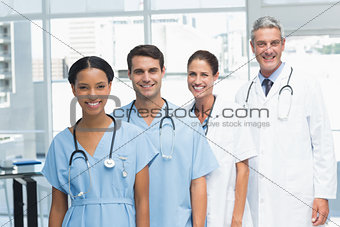 Portrait of confident doctors in row