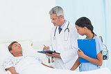 Doctor explaining report to patient