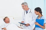 Doctor explaining report to patient