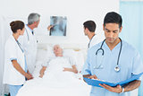 Report reading with colleagues and patient behind