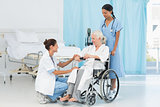 doctors and patient in wheelchair