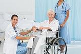 doctors and patient in wheelchair