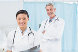 Confident male and female doctors