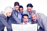 Surprising business people looking at newspaper