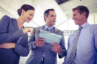 Business team using tablet together