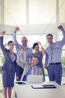 Business team having a meeting and cheering