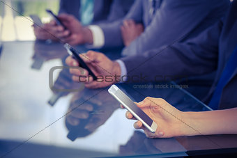 Business team using their smartphones